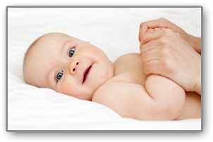 Infant boy in Melbourne enjoying the benefits of baby massage with Lauren Fink